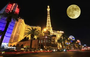9548074 - a full moon over paris on the strip taken in las vegas, nevada, on march 16, 2011. composite.
